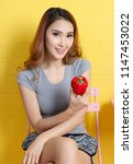 beautiful asian woman holding... | Shutterstock . vector #1147453022