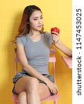beautiful asian woman holding... | Shutterstock . vector #1147453025