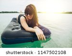 woman on mattress swimming in... | Shutterstock . vector #1147502108