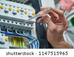 electrician works with electric ... | Shutterstock . vector #1147515965