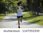 sporty fitness woman running at ... | Shutterstock . vector #1147552535