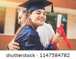 graduated student hugging her... | Shutterstock . vector #1147584782