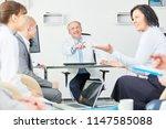 team of doctors in a meeting... | Shutterstock . vector #1147585088