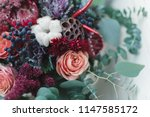 Stock photo bouquet of autumn flowers in red burgundy and shades of marsala ingredients protea roses 1147585172