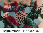 bouquet of autumn flowers in... | Shutterstock . vector #1147585202