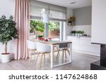 gray roman shades and a pink... | Shutterstock . vector #1147624868