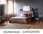 grey wooden armchair next to...   Shutterstock . vector #1147625555