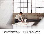 businessman working alone in a... | Shutterstock . vector #1147666295