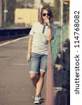 hipster girl at railways... | Shutterstock . vector #114768082