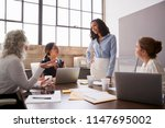 businesswoman listening to... | Shutterstock . vector #1147695002