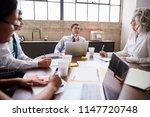 business team brainstorming in... | Shutterstock . vector #1147720748