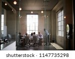 business colleagues at a... | Shutterstock . vector #1147735298