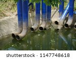 old blue drain water tubes and...   Shutterstock . vector #1147748618