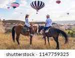 happy young couple on vacation... | Shutterstock . vector #1147759325