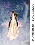 bridegroom kisses the bride... | Shutterstock . vector #1147822208