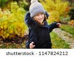 autumn portrait of happy kid... | Shutterstock . vector #1147824212