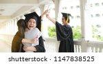 hugging her friend student in... | Shutterstock . vector #1147838525