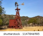 old windmill of former ranch... | Shutterstock . vector #1147846985