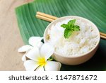 cooked rice in a bowl on banana ... | Shutterstock . vector #1147871672