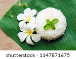 cooked rice on banana leaf | Shutterstock . vector #1147871675