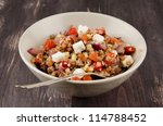 buckwheat salad with roasted peppers and feta - stock photo