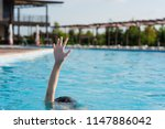 hand up in swimming pool | Shutterstock . vector #1147886042