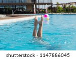beautiful female legs stick out ... | Shutterstock . vector #1147886045