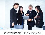 group of successful businessman.... | Shutterstock . vector #1147891268