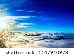 mountain peak in blue sky white ... | Shutterstock . vector #1147910978