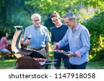 in summer  the family gathered... | Shutterstock . vector #1147918058