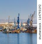 cranes in a shipyard | Shutterstock . vector #114793192