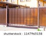 automatic gate in a private... | Shutterstock . vector #1147965158