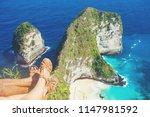leg of couple on kelingking... | Shutterstock . vector #1147981592