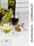 two glasses of red and white... | Shutterstock . vector #1148026625