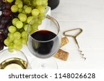 two glasses of red and white... | Shutterstock . vector #1148026628
