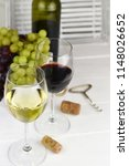 two glasses of red and white... | Shutterstock . vector #1148026652