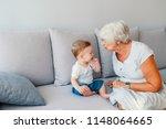 multi generation family... | Shutterstock . vector #1148064665