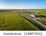 aerial view of corn field with... | Shutterstock . vector #1148073512