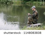 fishing in river.a fisherman... | Shutterstock . vector #1148083838