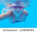 small girl swimming underwater | Shutterstock . vector #1148089082