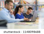 male teacher explaining topic... | Shutterstock . vector #1148098688