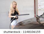 a blonde woman washing a suv car | Shutterstock . vector #1148106155