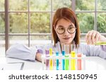 young female scientist student...   Shutterstock . vector #1148150945