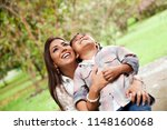 mom and son in the park | Shutterstock . vector #1148160068