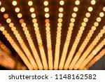 rows of illuminated globes... | Shutterstock . vector #1148162582
