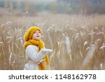 A Little Girl In A Yellow Hat...