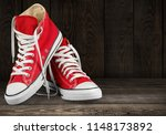 pair of new red sneakers | Shutterstock . vector #1148173892
