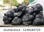 garbage bag on sidewalk  | Shutterstock . vector #1148184725
