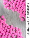 pink pom pom background | Shutterstock . vector #1148184815