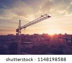 high yellow crane building a... | Shutterstock . vector #1148198588